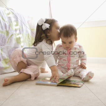 Girls with book.