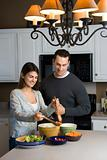 Couple in kitchen.