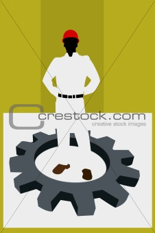 a man wearing hardhat standing inside a machine wheel