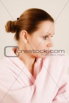 beautiful woman in pink bathrobe