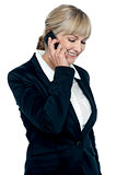 Corporate lady engaged in a business call