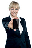 Sales executive displaying brand new multimedia phone