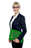 Confident corporate woman holding calculator