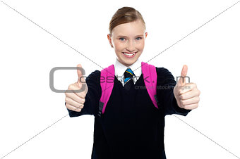 Bright student showing thumbs up sign
