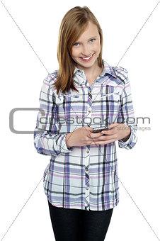 Casual teen girl messaging her friends