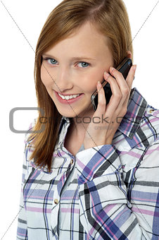 Close up of a pretty girl communicating on phone