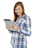 Attractive cute girl holding a tablet device