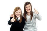 Charming daughter with her mother showing thumbs up sign