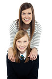 Cheerful duo of adorable mother and daughter
