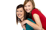 Mother giving daughter ride on back
