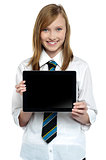 Pretty college girl displaying a tablet device