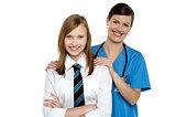 Graceful doctor posing with her teenage patient