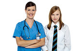 Confident medical expert posing with school girl