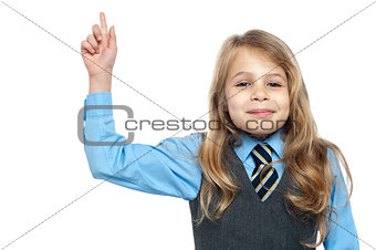 Charming school girl with raised arm