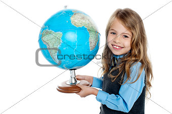 Beautiful school going kid holding globe