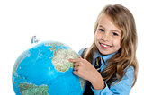 Disciplined child pointing at something on globe