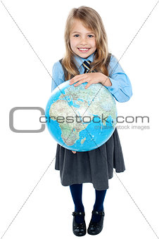 Aerial view of cute girl kid holding globe