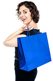Joyous woman posing with a shopping bag