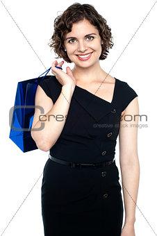 Attractive shopaholic woman carrying shopping bag
