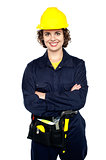 Confident female worker posing with arms crossed