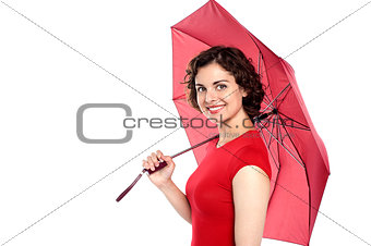 Attractive young woman holding an umbrella