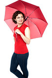 Beautiful young woman holding an umbrella