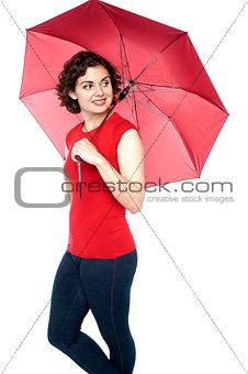 Beautiful young woman holding an umbrella