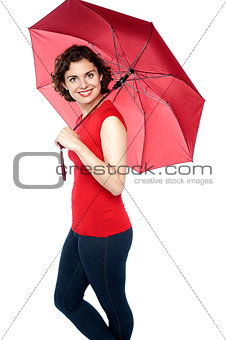 Beautiful woman holding a red umbrella