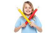 Young girl holding big red and yellow pencils