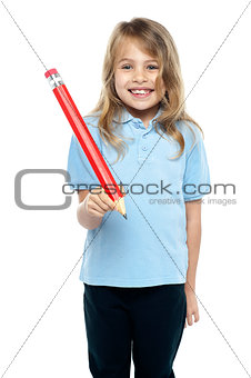 Charming kid with beautiful hair holding red pencil