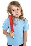 Straight faced kid holding huge red pencil
