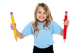 Innocent child posing with colorful pencils