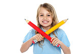 Charming school girl posing with big pencils