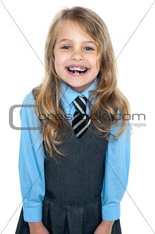An excited school girl in uniform wearing braces