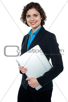 Business executive posing with laptop