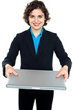 Pretty businesswoman presenting a laptop