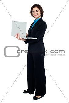Business executive browsing on laptop