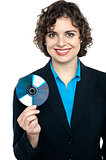 Charming corporate lady holding data disc