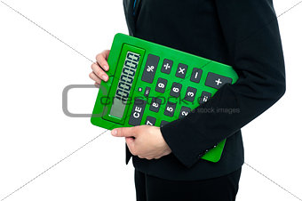Cropped image of a woman holding calculator