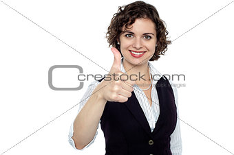 Charming young lady gesturing success
