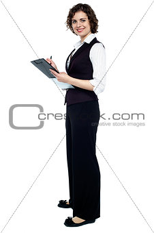 Charming business lady posing with a clipboard