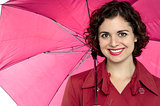 Beautiful woman holding an open umbrella