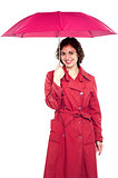 Young fashionable woman holding an umbrella