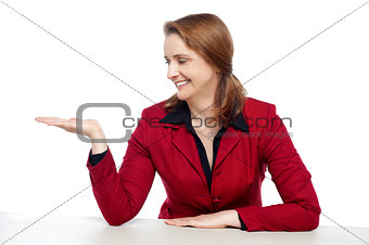 Attractive businesswoman presenting copy space