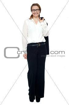 Business lady with coat slung over her shoulder