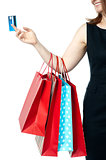 Woman holding colorful shopping bags and cash card