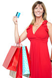 Gorgeous shopaholic woman in beautiful dress