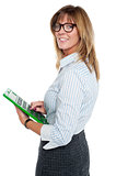 Corporate lady using big green calculator