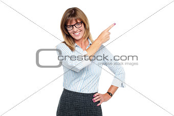 Charming business professional pointing away