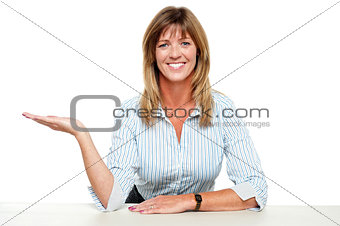 Business lady posing with an open palm